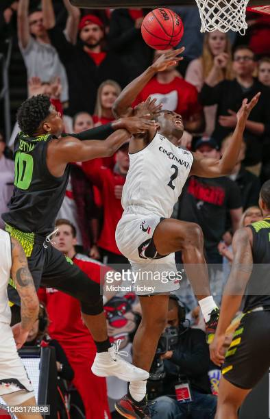 Keith Williams of the Cincinnati Bearcats loses the ball as Alexis Yetna of the South Florida Bulls defends during the first half of the game at...