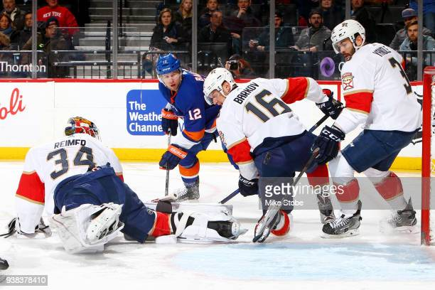 Keith Yandle Aleksander Barkov and James Reimer of the Florida Panthers defend the net from a shot by Josh Bailey of the New York Islanders during...