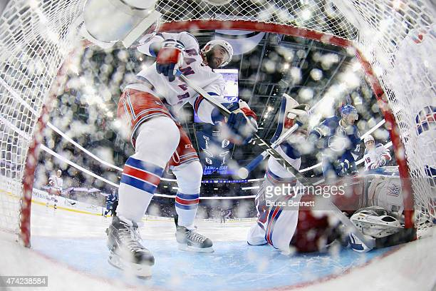 Keith Yandle and Henrik Lundqvist of the New York Rangers defend against the Tampa Bay Lightning in Game Three of the Eastern Conference Finals...