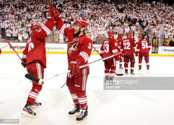 Keith Yandle and Mikkel Boedker of the Phoenix Coyotes celebrate after an overtime victory against the Nashville Predators in Game One of the Western...