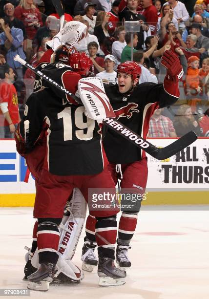 Keith Yandle and Shane Doan of the Phoenix Coyotes celebrate with goaltender Ilya Bryzgalov after defeating the Chicago Blackhawks in an overtime...