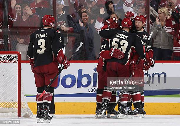 Keith Yandle Andy Miele Derek Morris and David Moss of the Phoenix Coyotes celebrate after Morris scored a second period goal against the Los Angeles...