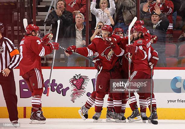 Keith Yandle, Antoine Vermette, Matthew Lombardi, Shane Doan and David Schlemko of the Phoenix Coyotes celebrate after scoring against the Chicago...