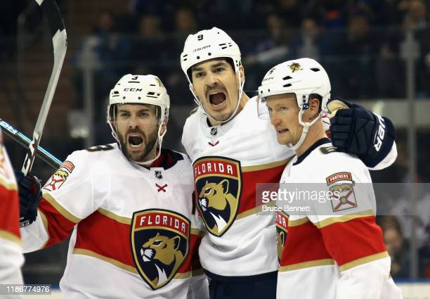 Keith Yandle, Brian Boyle and Anton Stralman of the Florida Panthers celebrate Boyle's game tying goal at 7:01 of the third period against the New...