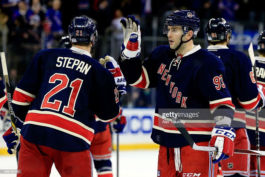 lowest price 47cd6 793a9 Keith Yandle high-fives Derek Stepan of the New York Rangers ...