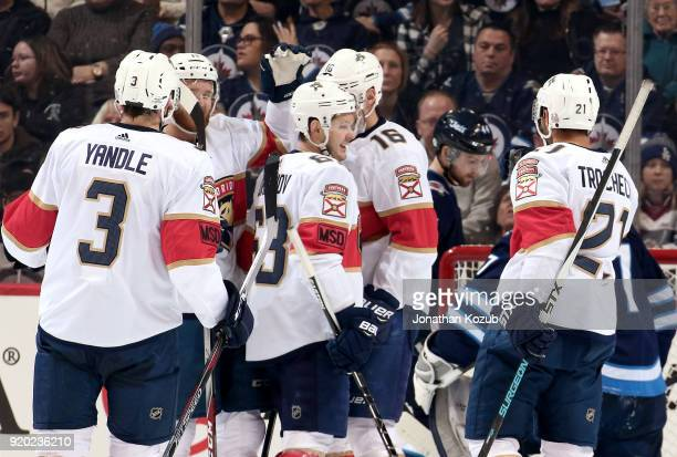 Keith Yandle Jonathan Huberdeau Evgenii Dadonov Aleksander Barkov and Vincent Trocheck of the Florida Panthers celebrate a second period goal against...