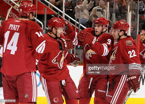 Keith Yandle Lee Stempniak Vernon Fiddler and Taylor Pyatt of the Phoenix Coyotes celebrate after a goal against the Anaheim Ducks on January 15 2011...