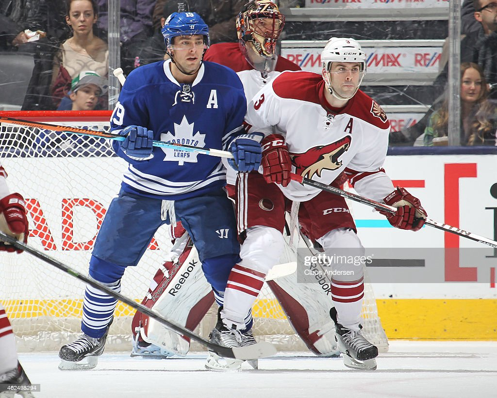 Keith Yandle #3 of the Arizona Coyotes battles against Joffrey Lupul #19 of the Toronto Maple Leafs during an NHL game at the Air Canada Centre on January 29, 2015 in Toronto, Ontario, Canada. The Coyotes defeated the Leafs 3-1.
