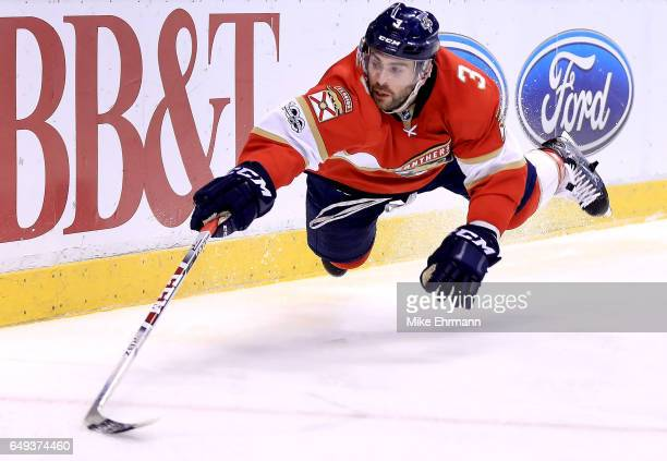 Keith Yandle of the Florida Panthers dives for the puck during a game against the New York Rangers at BB&T Center on March 7, 2017 in Sunrise,...