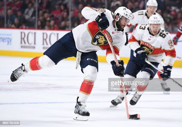 Keith Yandle of the Florida Panthers fires a slap shot against the Montreal Canadiens in the NHL game at the Bell Centre on October 24 2017 in...