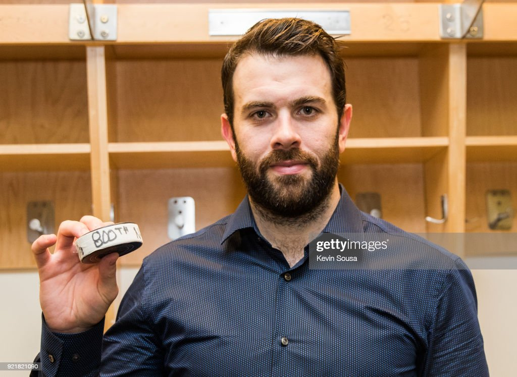 Keith Yandle #3 of the Florida Panthers holds a puck from his 800th game, after playing the Toronto Maple Leafs at the Air Canada Centre on February 20, 2018 in Toronto, Ontario, Canada.