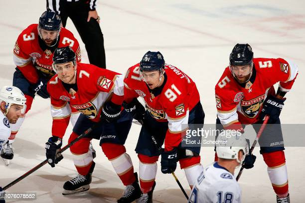 Keith Yandle of the Florida Panthers lines up for a face off with teammates Colton Sceviour, Juho Lammikko and Aaron Ekblad against the Tampa Bay...