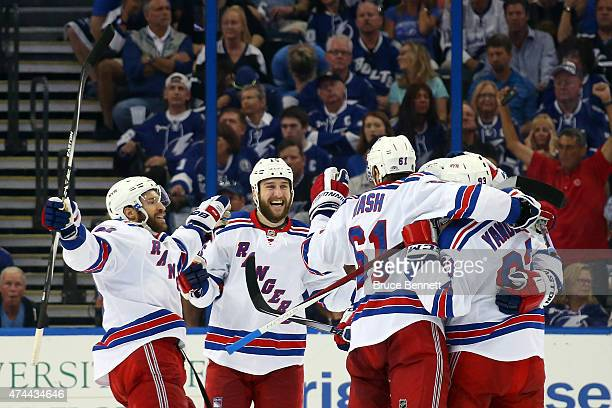 Keith Yandle of the New York Rangers celebrates with his teammates after scoring a goal against Ben Bishop of the Tampa Bay Lightning during the...