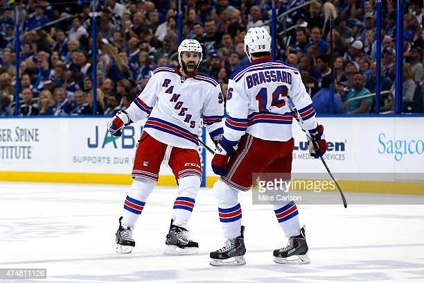 Keith Yandle of the New York Rangers celebrates with teammate Derick Brassard after a goal against Ben Bishop of the Tampa Bay Lightning during the...