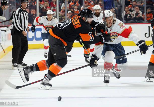 Keith Yandle of the Philadelphia Flyers checks Mason Marchment of the Florida Panthers at the blue line as they battle for control of the loose puck...