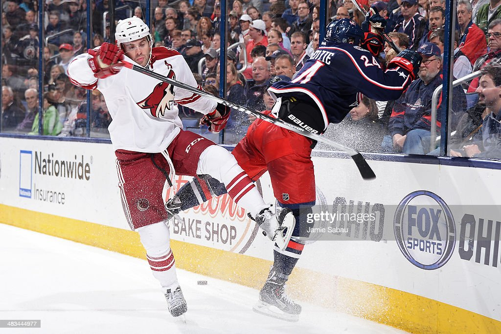 Keith Yandle #3 of the Phoenix Coyotes and Derek MacKenzie #24 of the Columbus Blue Jackets collide during the third period on April 8, 2014 at Nationwide Arena in Columbus, Ohio. Columbus defeated Phoenix 4-3 in overtime.