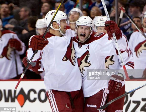 Keith Yandle of the Phoenix Coyotes celebrates with Adrian Aucoin after scoring a goal against the Vancouver Canucks during the third period in NHL...