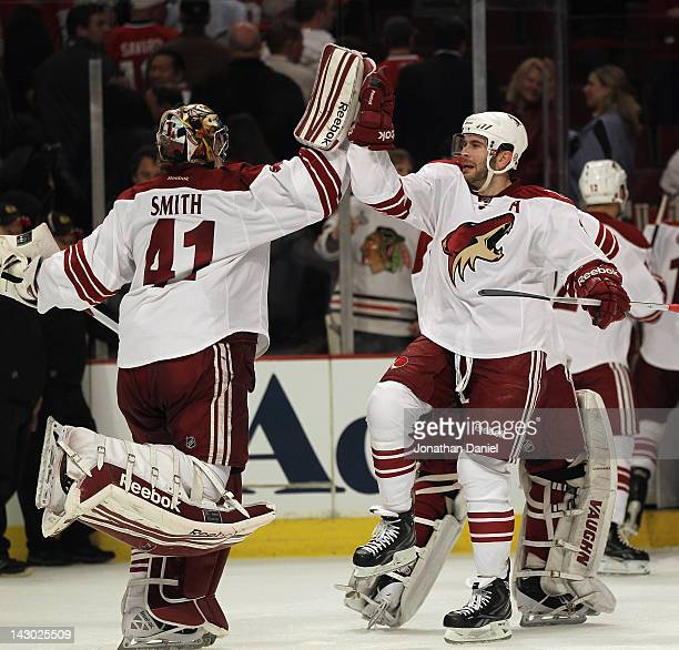 Keith Yandle of the Phoenix Coyotes celebrates with Mike Smith after a win against the Chicago Blackhawks in Game Three of the Western Conference...