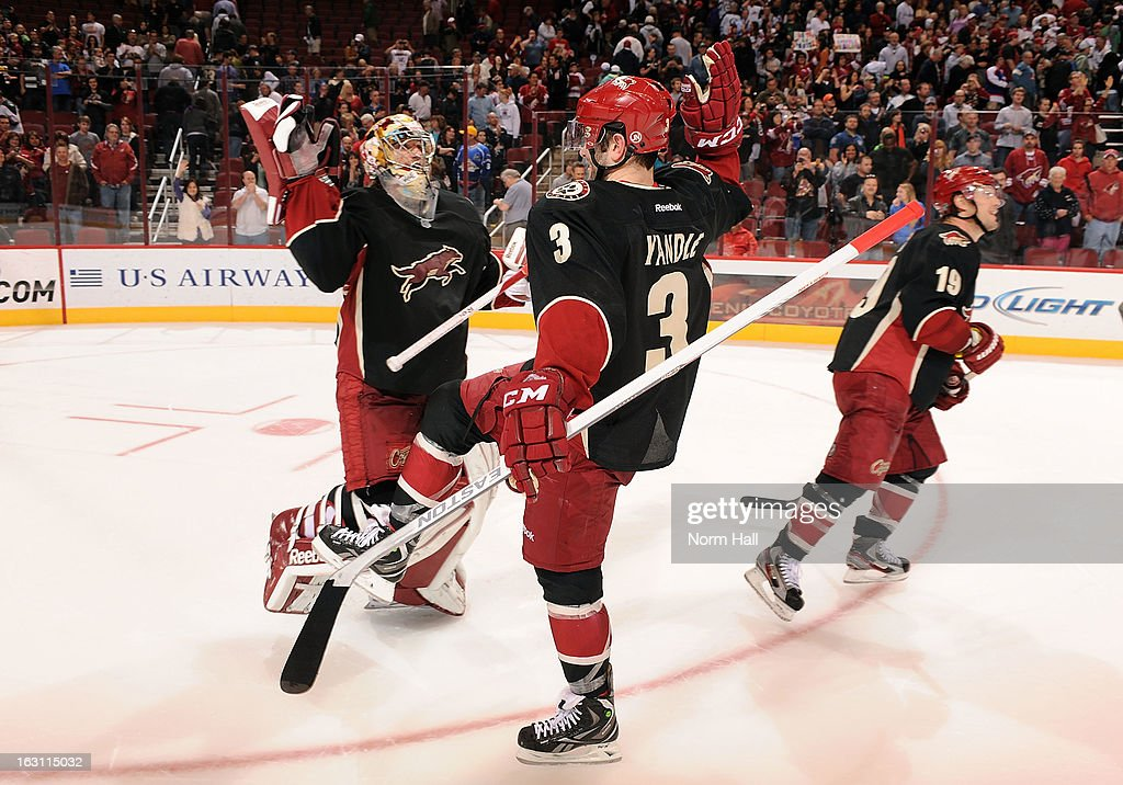 Keith Yandle #3 of the Phoenix Coyotes high fives goalie Mike Smith #41 after a 5-4 shootout victory over the Anaheim Ducks at Jobing.com Arena on March 4, 2013 in Glendale, Arizona.