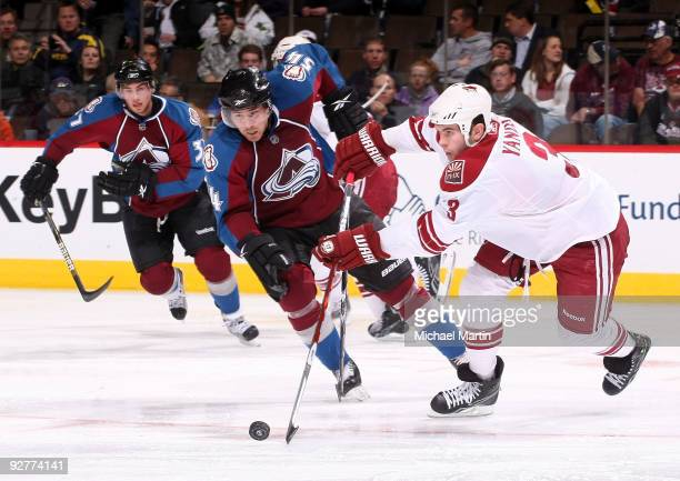 Keith Yandle of the Phoenix Coyotes skates against David Jones of the Colorado Avalanche at the Pepsi Center on November 4 2009 in Denver Colorado