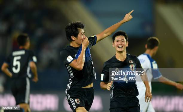 Keito Nakamura of Japan celebrates scoring the opening goal during the FIFA U17 World Cup India 2017 group E match between Honduras and Japan at...