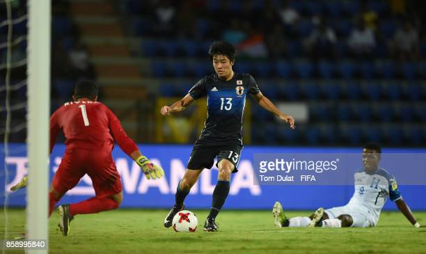 Keito Nakamura of Japan on his way to scoring his sides second goal during the FIFA U17 World Cup India 2017 group E match between Honduras and Japan...