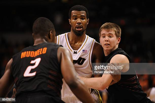 Keiton Page of the Oklahoma State Cowboys and Zaire Taylor of the Missouri Tigers during the Phillips 66 Big 12 Men's Basketball Championship...