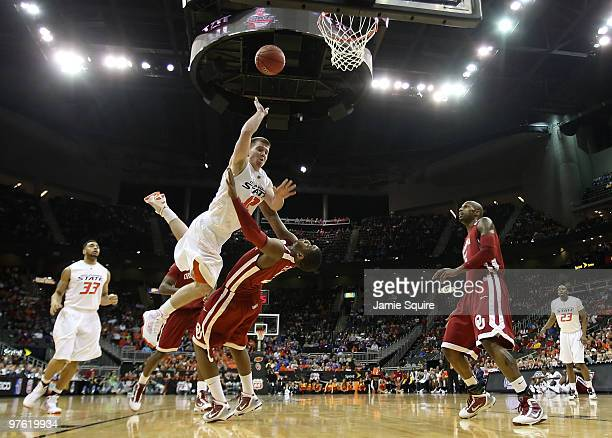 Keiton Page of the Oklahoma State Cowboys goes up for a shot over Steven Pledger of the Oklahoma Sooners during the first round game of the 2010...