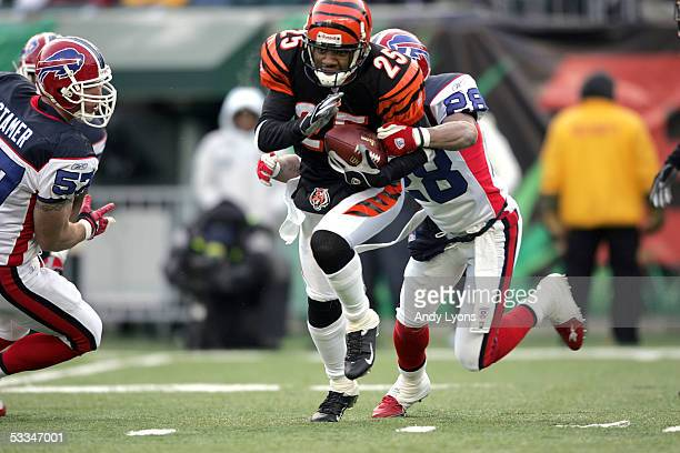 Keiwan Ratliff of the Cincinnati Bengals attempts to run through the tackle by Kevin Thomas of the Buffalo Bills during the game at Paul Brown...