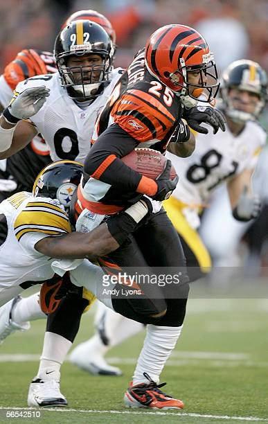 Keiwan Ratliff of the Cincinnati Bengals is brought down by James Harrison and Chidi Iwuoma of the Pittsburgh Steelers during the first quarter of...