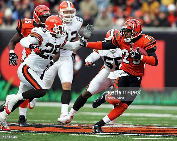 Keiwan Ratliff of the Cincinnati Bengals runs back a punt against Chris Crocker the Cleveland Browns on November 28, 2004 at Paul Brown Stadium in...