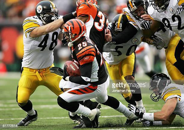 Keiwan Ratliff of the Cincinnati Bengals runs the ball against the Pittsburgh Steelers defense on November 21, 2004 at Paul Brown Stadium in...