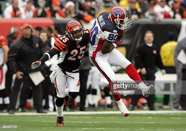 Keiwan Ratliff of the Cincinnati Bengals tackles Eric Moulds of the Buffalo Bills during the NFL game at Paul Brown Stadium on December 24, 2005 in...