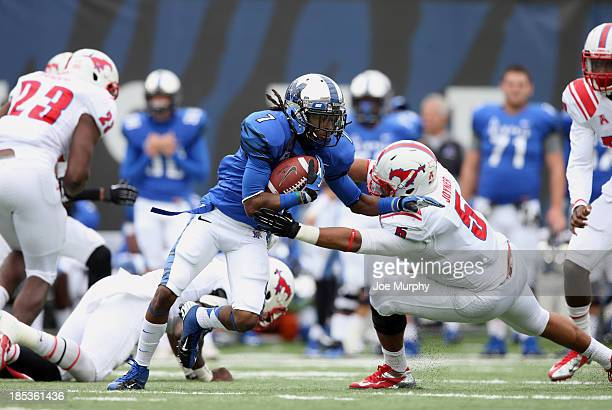 Keiwone Malone of the Memphis Tigers runs with the ball against Randall Joyner of the SMU Mustangs on October 19, 2013 at Liberty Bowl Memorial...