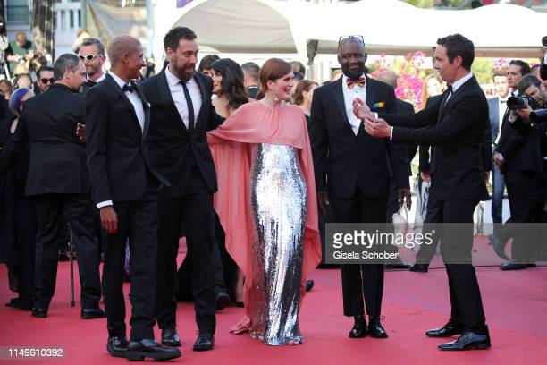 Keiynan Lonsdale Dan Krauss Julianne Moore and Steve Williams attend the screening of Rocketman during the 72nd annual Cannes Film Festival on May 16...