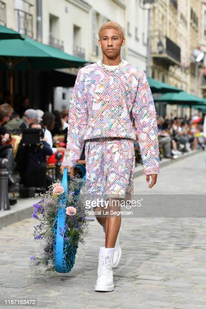 Keiynan Lonsdale walks the runway during the Louis Vuitton Menswear Spring Summer 2020 show as part of Paris Fashion Week on June 20 2019 in Paris...