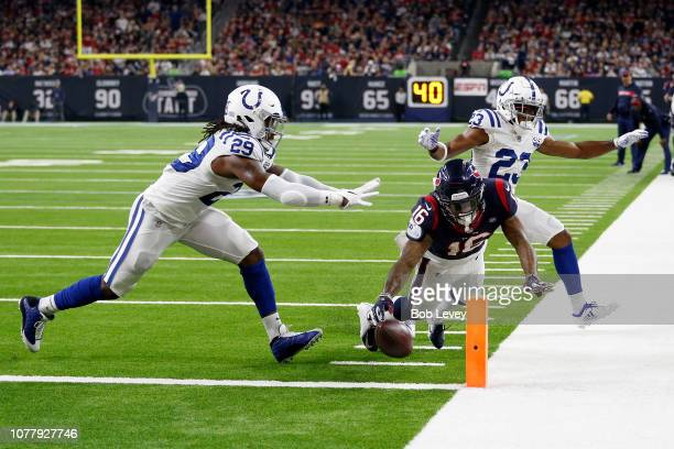 Keke Coutee of the Houston Texans dives for a touchdown defended by Malik Hooker and Kenny Moore of the Indianapolis Colts in the fourth quarter...