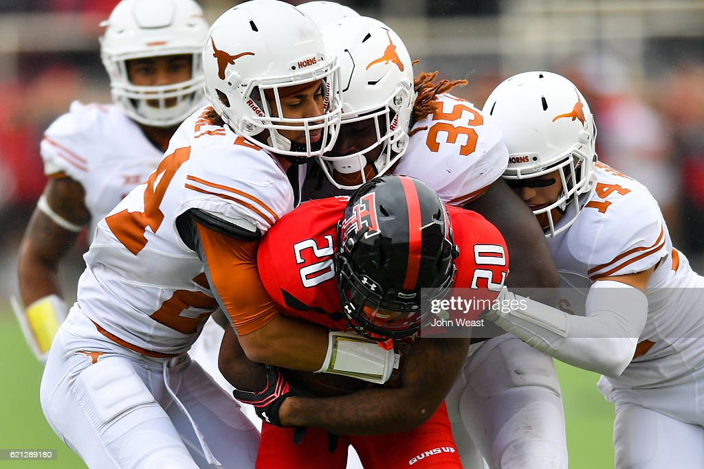 Keke Coutee #20 of the Texas Tech Red Raiders is gang tackled by the Texas Longhorns defense during the game on November 5, 2016 at AT&T Jones Stadium in Lubbock, Texas. Texas defeated Texas Tech 45-37.