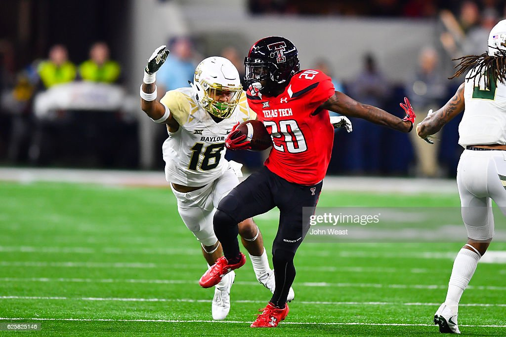 Keke Coutee #20 of the Texas Tech Red Raiders tries to outrun Chance Waz #18 of the Baylor Bears during the game on November 25, 2016 at AT&T Stadium in Arlington, Texas. Texas Tech defeated Baylor 54-35.