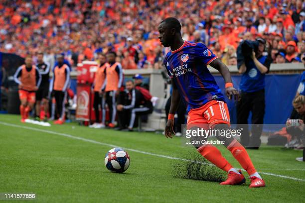 Kekuta Manneh of the Cincinnati FC controls the ball in the match against the Sporting Kansas City at Nippert Stadium on April 07 2019 in Cincinnati...