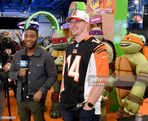 Kel Mitchell and Andy Dalton of the Cincinnati Bengals at the Nickelodeon Activation at the NFL Experience at Super Bowl LI in Houston Texas
