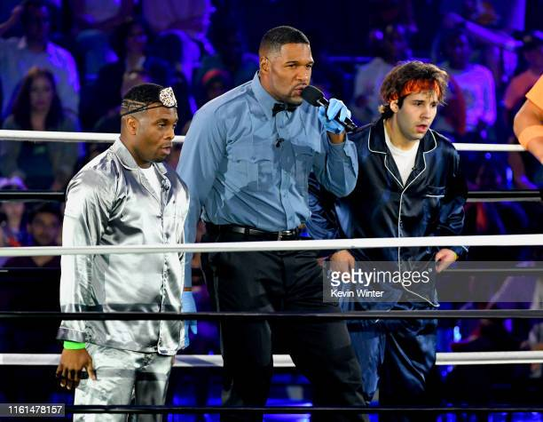 Kel Mitchell host Michael Strahan and David Dobrik participate in a challenge onstage during Nickelodeon Kids' Choice Sports 2019 at Barker Hangar on...