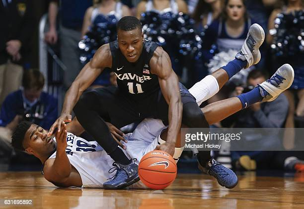 Kelan Martin of the Butler Bulldogs and Malcolm Bernard of the Xavier Musketeers battle for the ball at Hinkle Fieldhouse on January 14 2017 in...