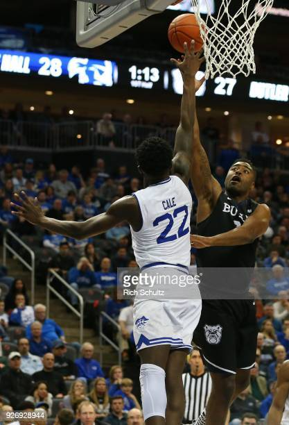 Kelan Martin of the Butler Bulldogs attempts a shot as Myles Cale of the Seton Hall Pirates defends during the first half of a game at Prudential...