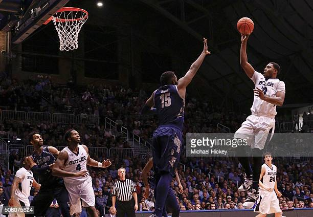 Kelan Martin of the Butler Bulldogs shoots the ball against Jessie Govan of the Georgetown Hoyas at Hinkle Fieldhouse on February 2 2016 in...