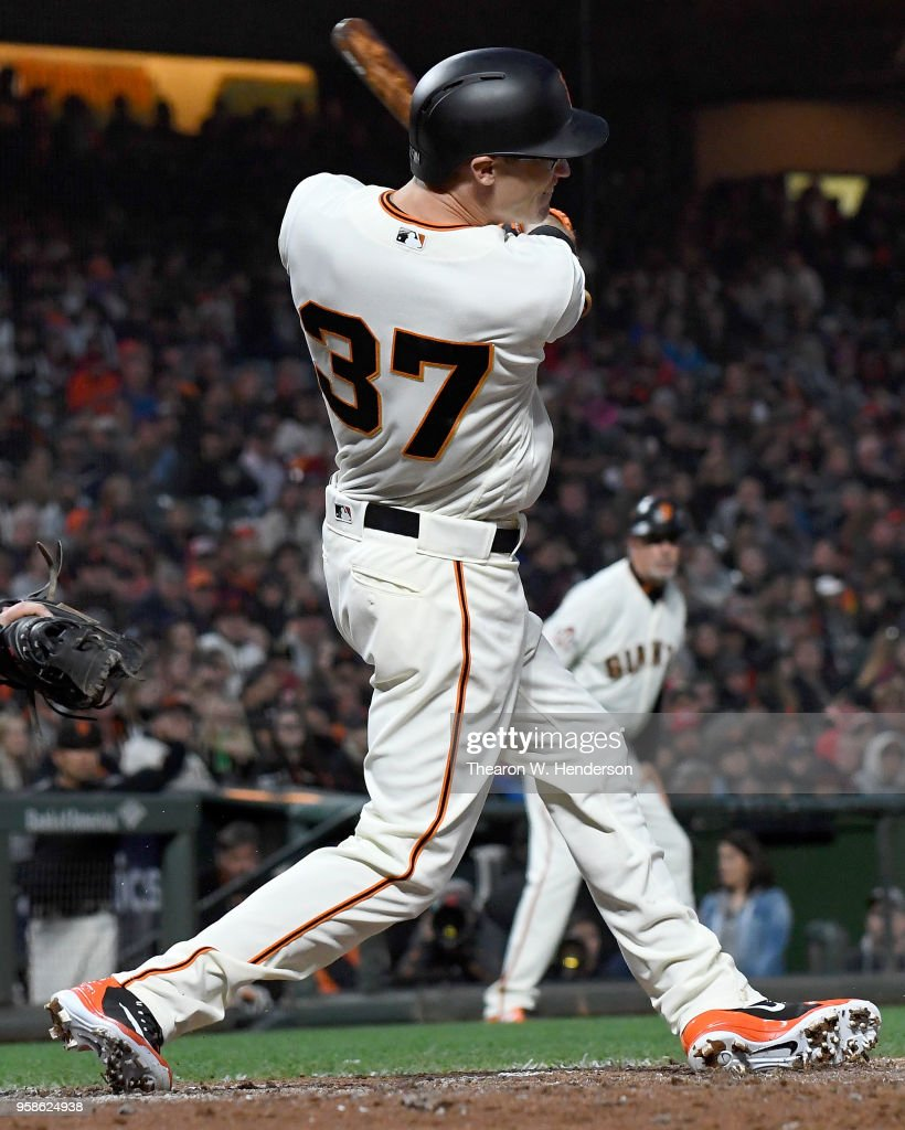 Kelby Tomlinson #37 of the San Francisco Giants hits a bases loaded two-run rbi single against the Cincinnati Reds in the bottom of the third inning at AT&T Park on May 14, 2018 in San Francisco, California.