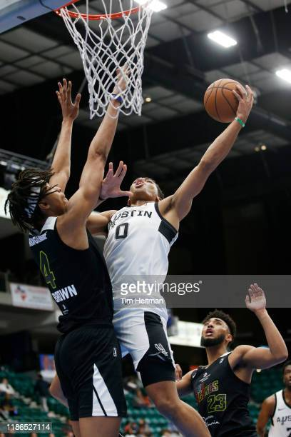 Keldon Johnson of the Austin Spurs drives on Moses Brown of the Texas Legends during the third quarter on December 4th, 2019 at Comerica Center in...