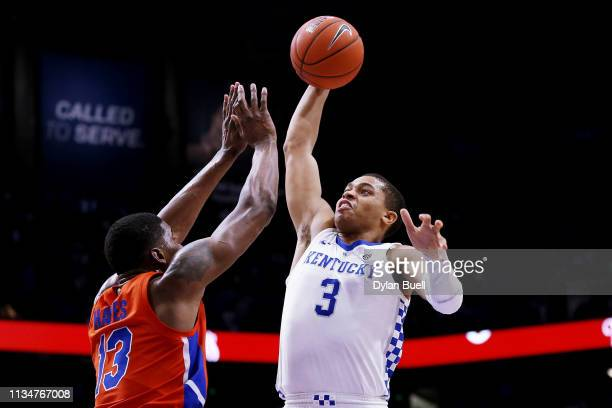 Keldon Johnson of the Kentucky Wildcats attempts a dunk while being guarded by Kevarrius Hayes of the Florida Gators in the second half at Rupp Arena...