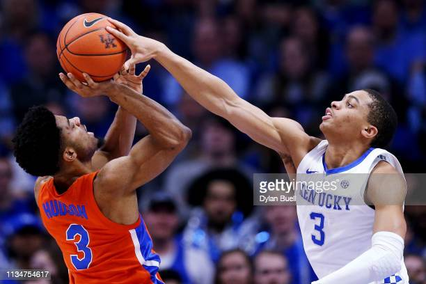 Keldon Johnson of the Kentucky Wildcats blocks a shot attempt by Jalen Hudson of the Florida Gators in the first half at Rupp Arena on March 09 2019...