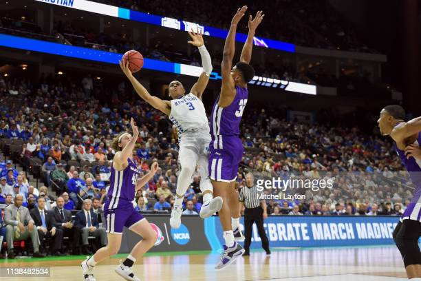 Keldon Johnson of the Kentucky Wildcats takes a shot over Joe Pleasant of the Abilene Christian Wildcats during the First Round of the NCAA...